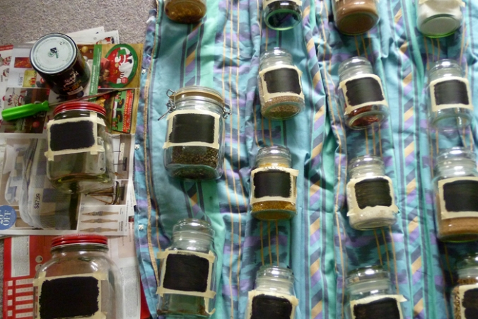 Jars with blackboard paint drying